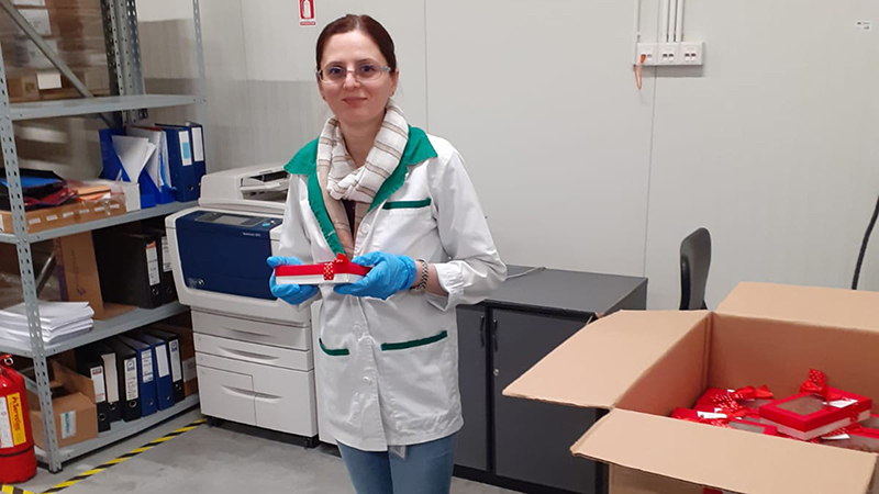 Nona Pipiriga, a worker at the Alliance Healthcare warehouse in Timisoara, Romania, receives her gift.