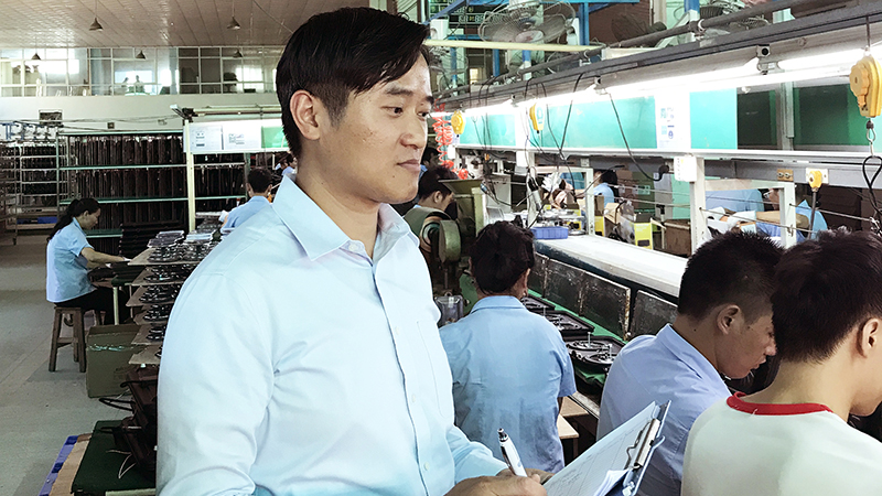 Lewis Chow, an ethical sourcing manager for WBA Global Brands Asia, conducts an inspection at one of the facilities that manufactures WBA owned-brand products.