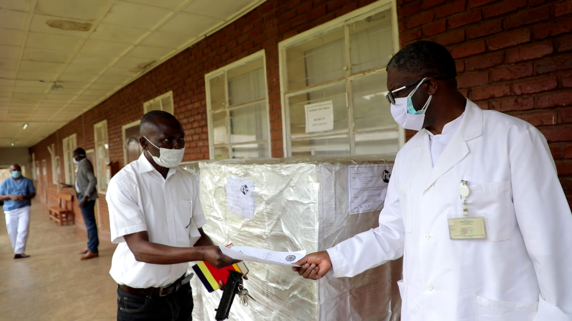 Doctor at Panzi hospital receiving donations shipment