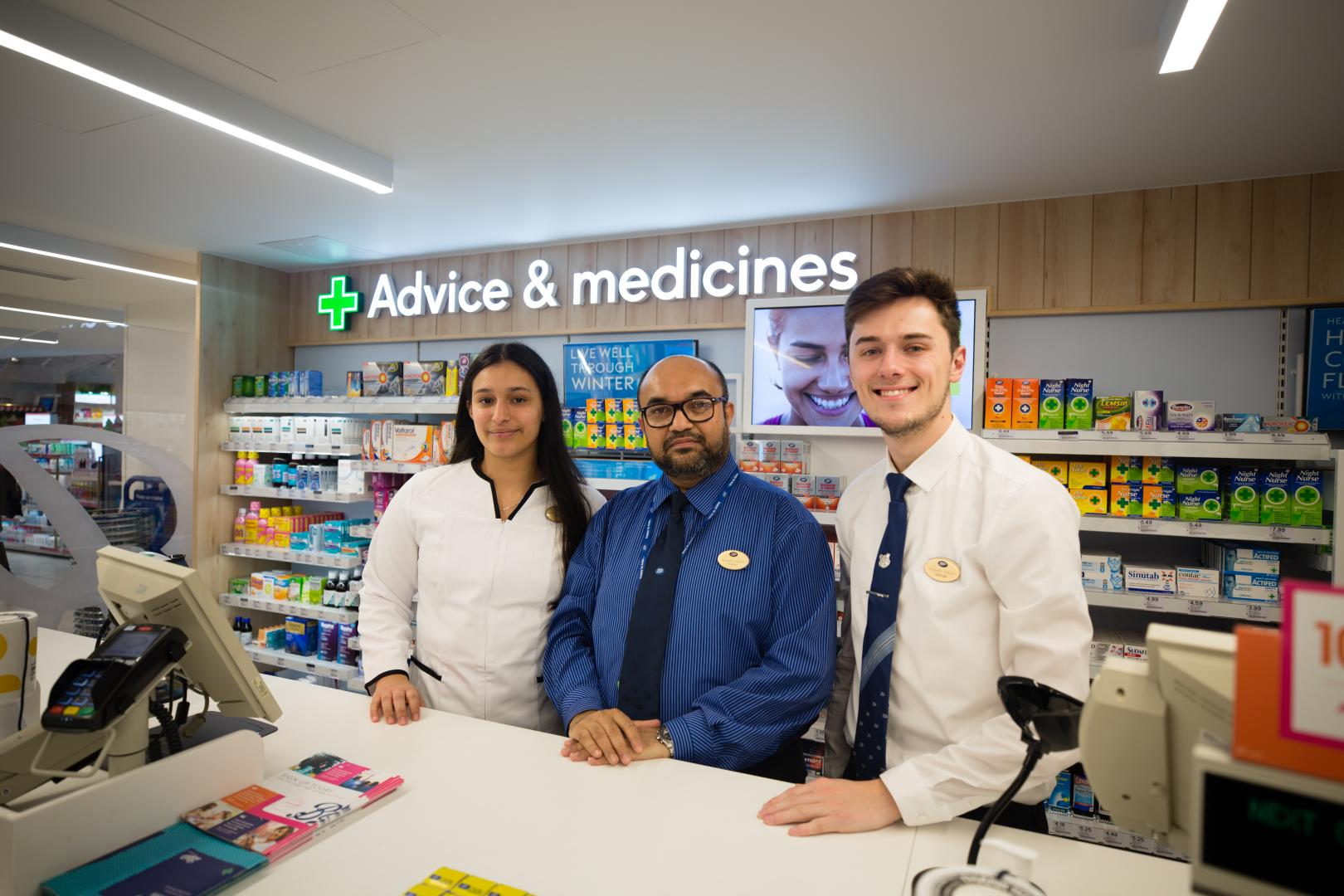 Boots opticians and pharmacists at checkout counter