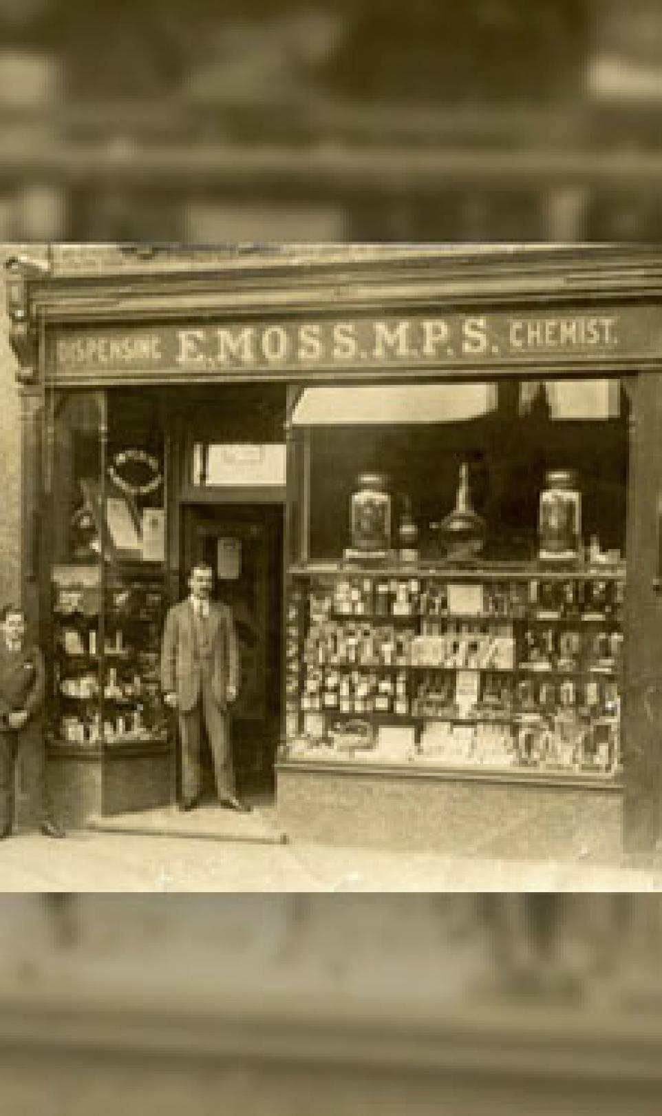 Photo of Edgar Moss outside of his first Moss Chemists store in Middlesex, UK