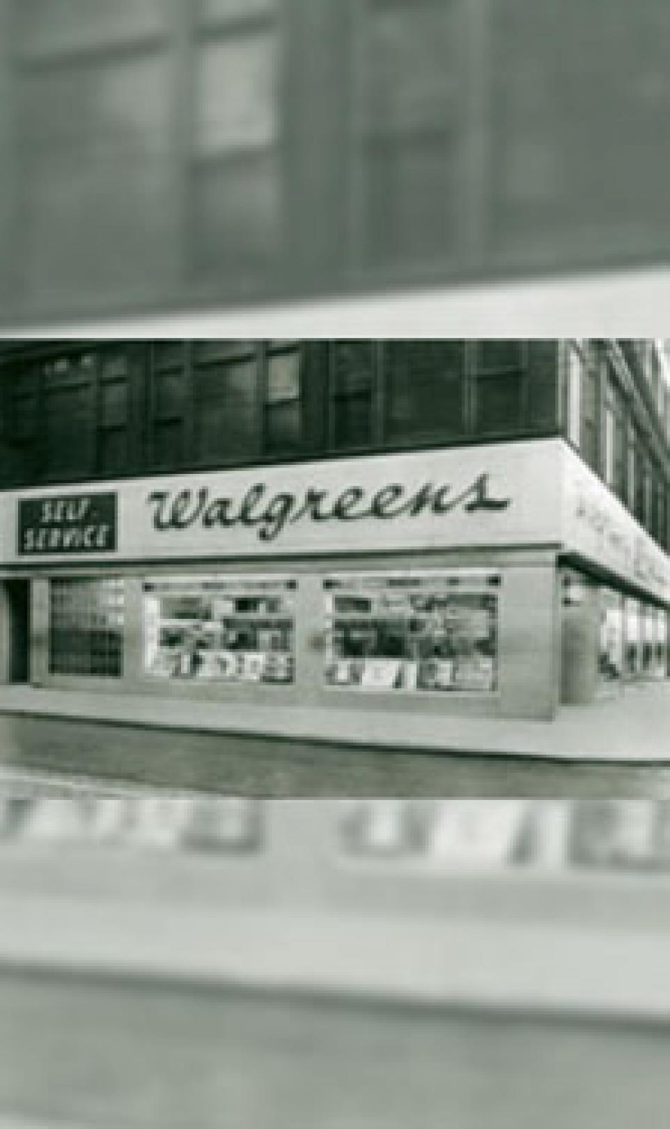 Storefront black and white photograph of a Walgreens self-service store