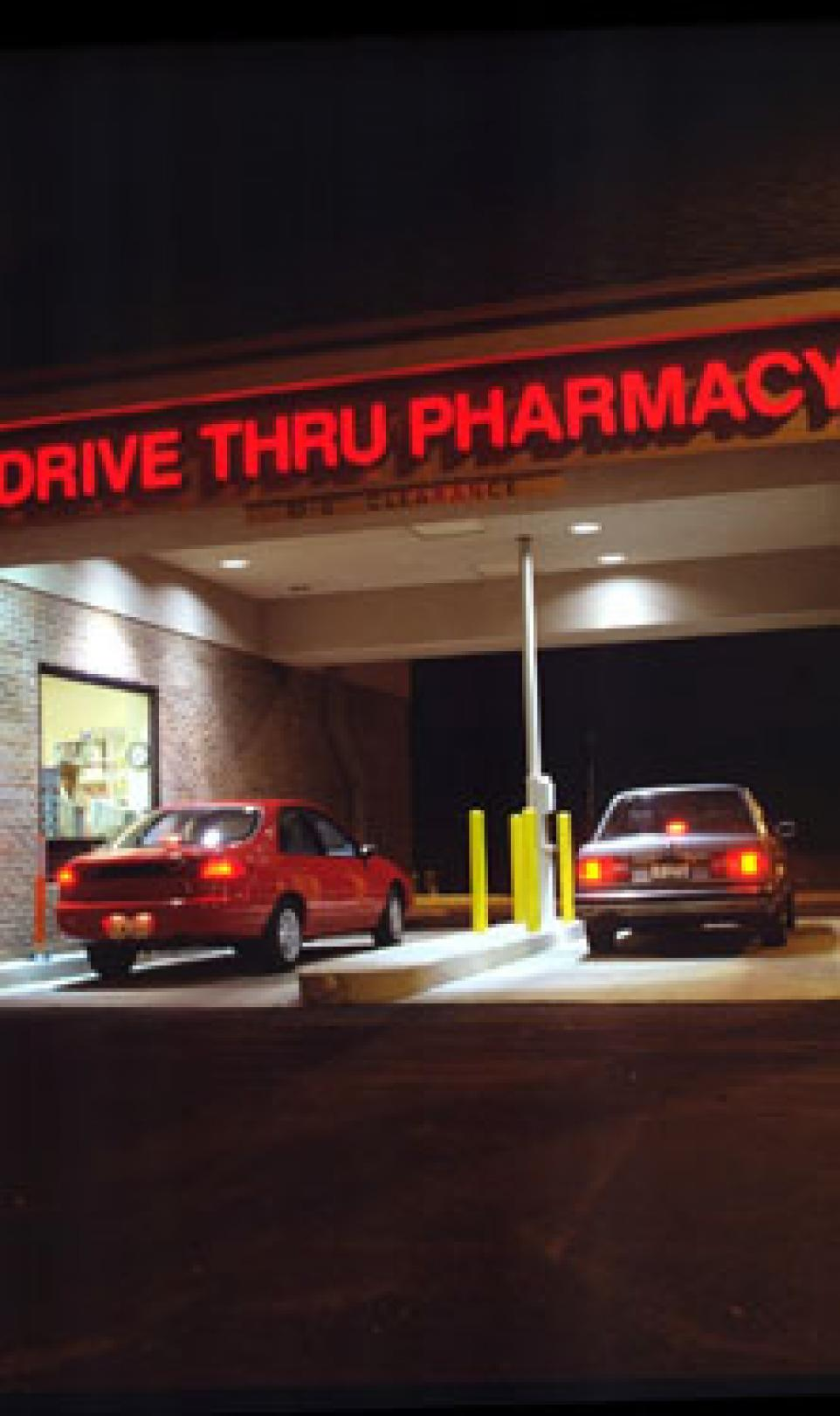 Outside view of a Walgreens drugstore with a drive-thru pharmacy
