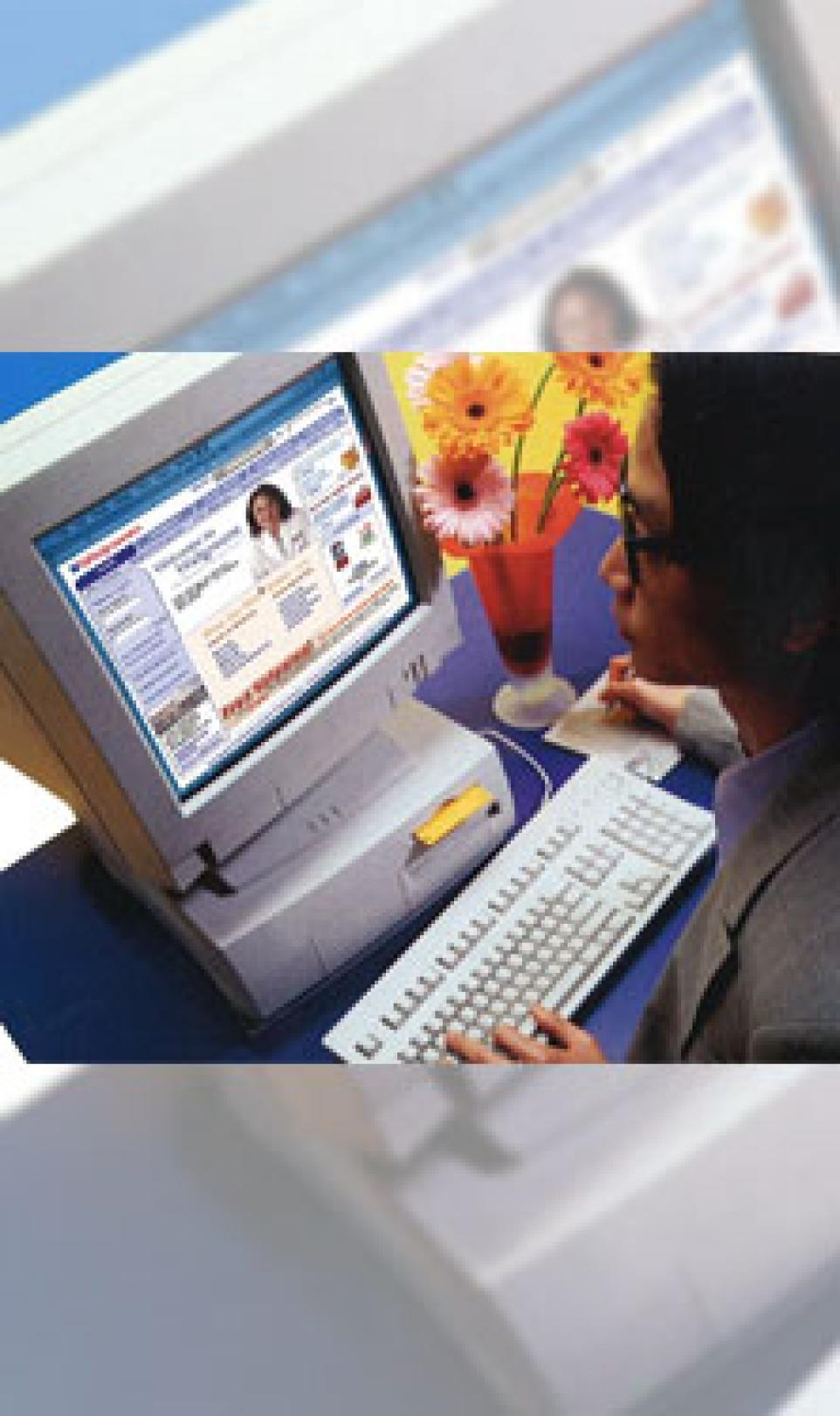 A woman using a 90's computer to access the Walgreens.com online pharmacy