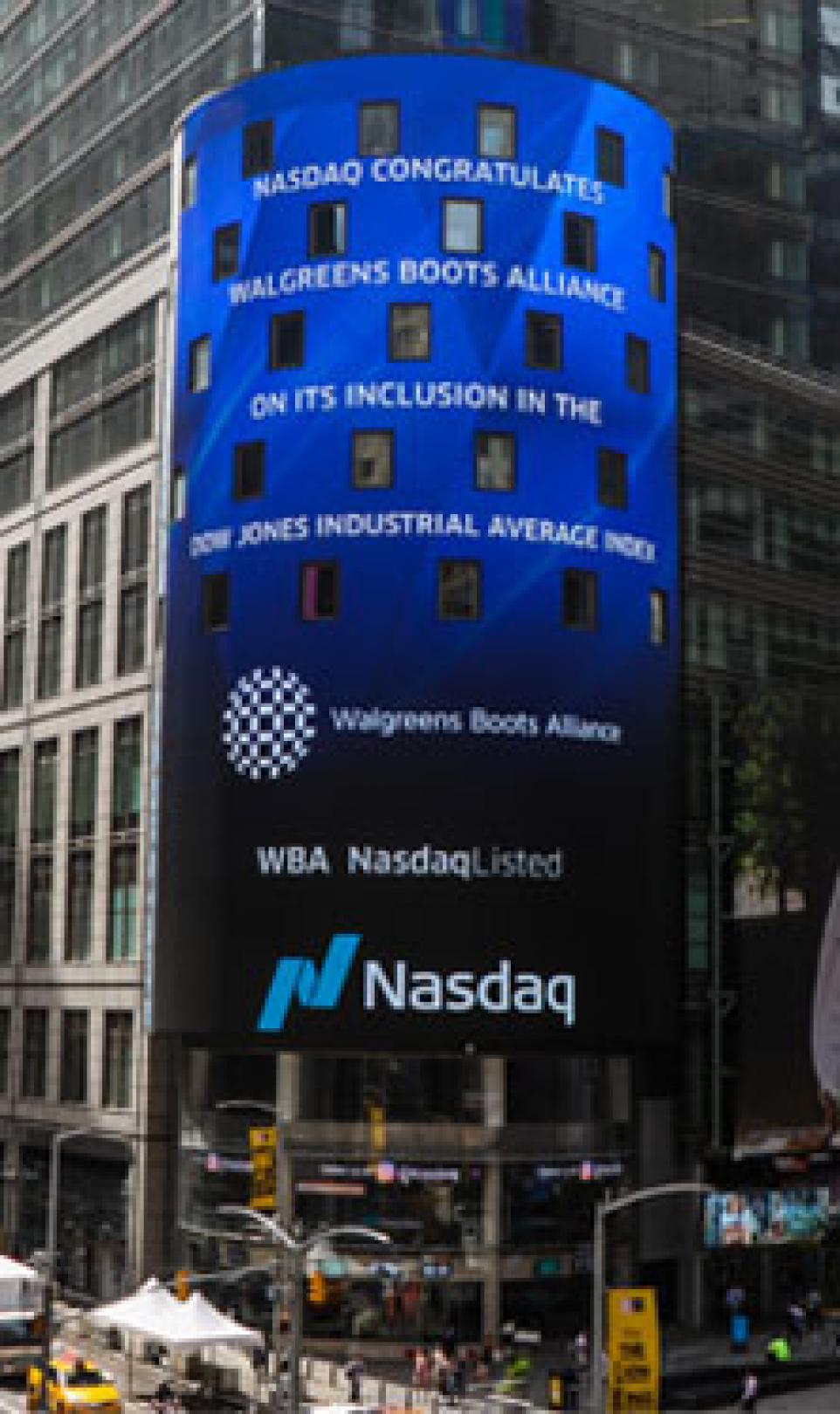 Advertisement on a building showing that Walgreens Boots Alliance has joined the Dow Jones Industrial Average